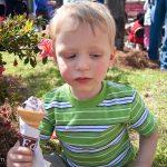 Enjoying cherry ice cream in the shade.