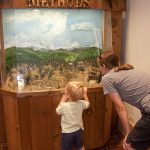Heidi and Trey check out one of the diorama