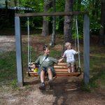 Trey and Kenny enjoy a swing