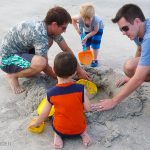 Trey plays with his uncle Kenny, Jason Jensen, and Jameson Jensen at the beach