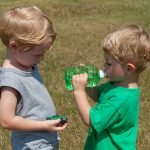 Trey & Hugo share water on a hot, Georgia summer day.