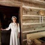The volunteer re-enactor at the log cabin museum