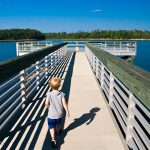 Trey runs out on the pier excited to see the boats at Bobby Brown State Park
