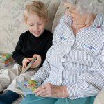 Grammaw reads a book to Trey