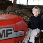 """A must of every visit is a """"ride"""" on the tractor"""
