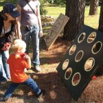 Playing bean bag toss at the Fall Festival.