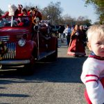Hudson Crosby on the sidelines as his great-father arrives as Santa on an antique fire truck
